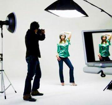 Woman shooting photos in a studio session